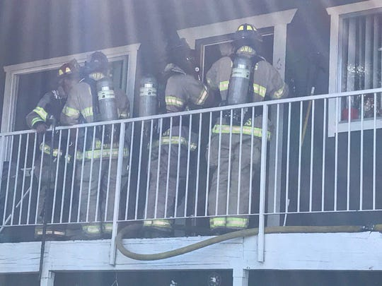 Redding firefighters work on an apartment fire on Masonic Avenue near Lake Boulevard Thursday afternoon.