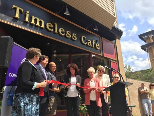Chef and owner Dwayne Spencer cuts the ribbon at Timeless Cafe flanked by (from left) Commissioner Jo Ellen Litz, Community First Fund Vice-president Dan Beck, Mayor Sherry Capello, Lebanon Business Improvement District manager Kelly Withum, Commissioner Bill Ames and friend Lois Pfoutz.