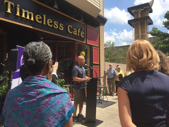 New owner and chef of Timeless Cafe, Dwayne Spencer makes remarks at the ribbon cutting for the restaurant located at 18 S. 8th St., in Lebanon.