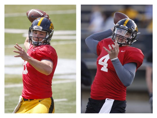 Tyler Wiegers, left, and Nathan Stanley are competing to be Iowa's starting quarterback.