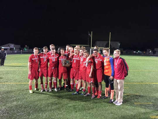 The New Richmond Lions boys soccer team coached by