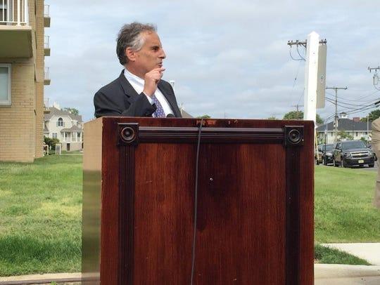 Long Branch Mayor Adam Schneider speaks at a boardwalk