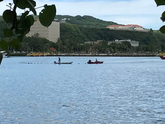 Boats in the water appear to be attempting to retrieve