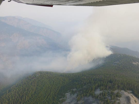 The Sheep Gap fire nine miles west of western Montana's Plains was one of the new fires sparked by a lightning storm Wednesday.