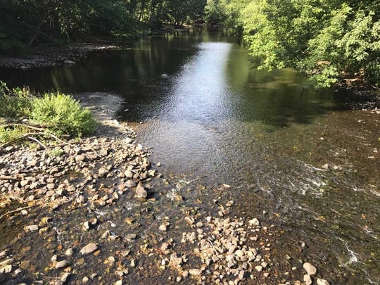 A waterway preservation project on the Ramapo River, shown here looking south from Lenape Lane in Oakland, has been delayed by a state request to assess Native American relics believed to be in the area.