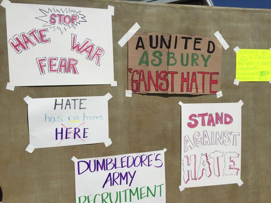 Signs at Asbury Park's 'Stand Against Hate' rally.