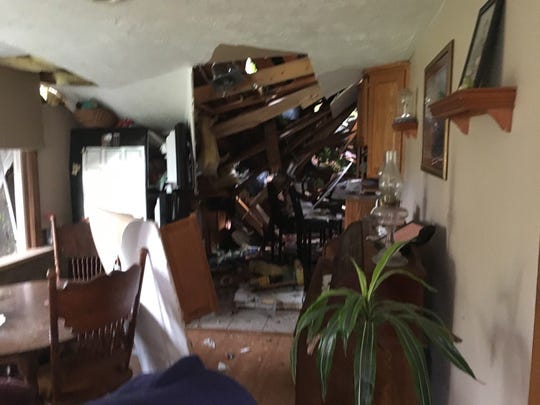 Storms Monday night left this mess inside Sherri Hager's house on Stiving Road.