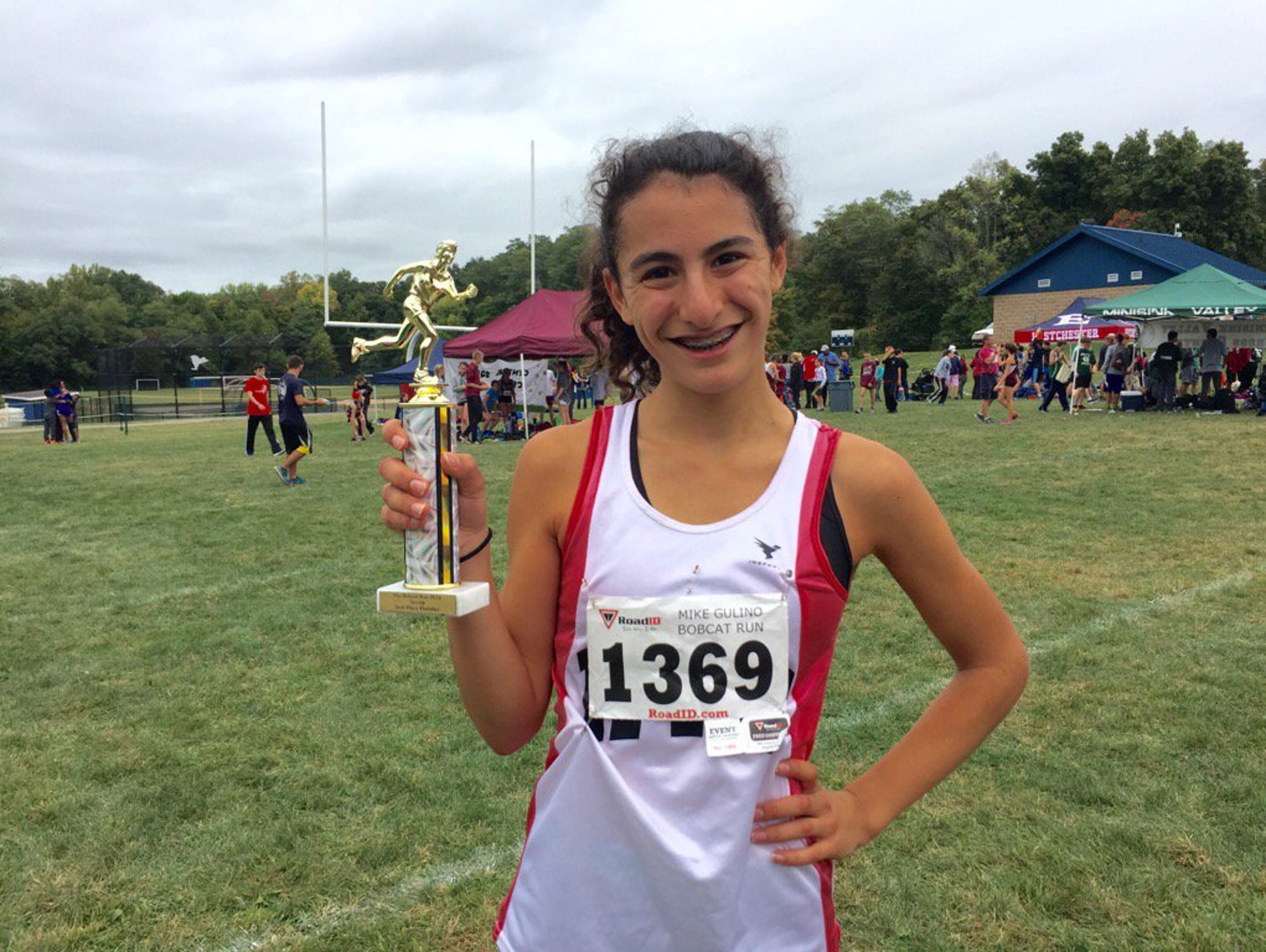 Natalie Weiner stands with second-place trophy afer