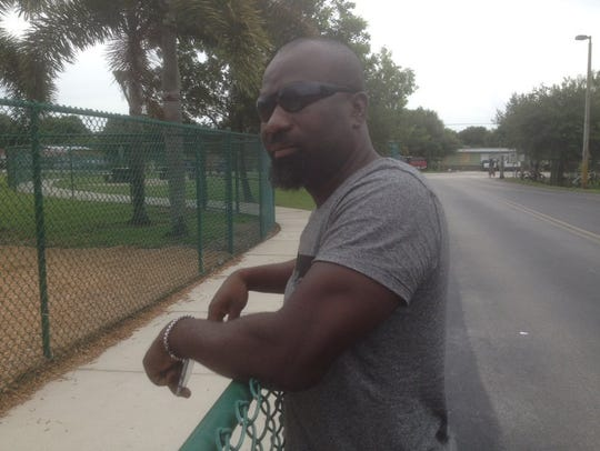 Jean Louis was waiting outside Pinecrest Elementary