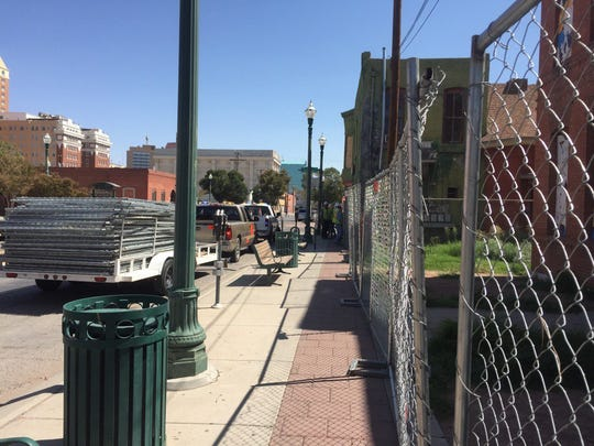 Chain-link fences were put up around buildings at the corner of Overland Avenue and Chihuahua Street Monday.