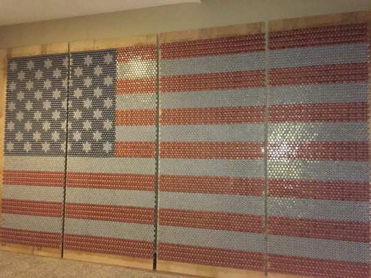 Chris Bedwell used nearly 13,000 beer bottle caps to create a flag work of art.