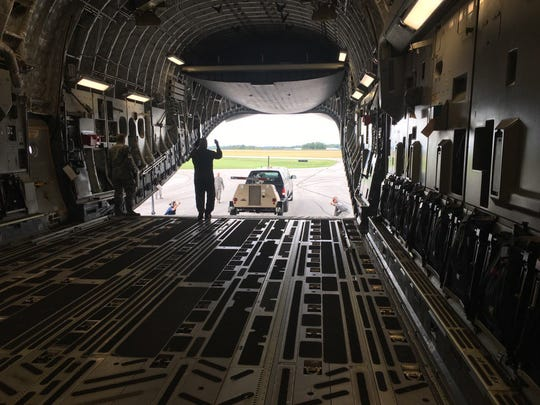 Gear is loaded onto a C7 aircraft Wednesday in preparation for deployment.