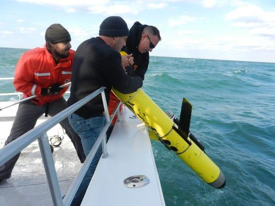 On Nov. 5, 2012, Travis Miles (left), Capt. Jared Polick