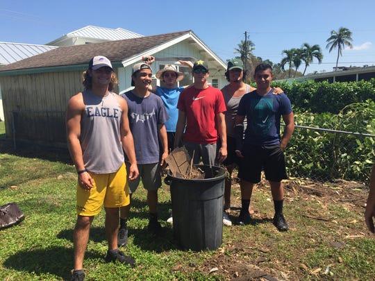 Naples High School football players helped their neighbors clean up debris following Hurricane Irma.