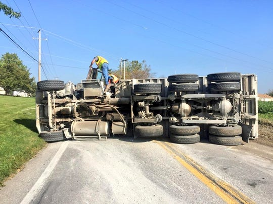 Susquehanna Trail North in Manchester Township had been closed after a dump truck rolled onto its side, police said.