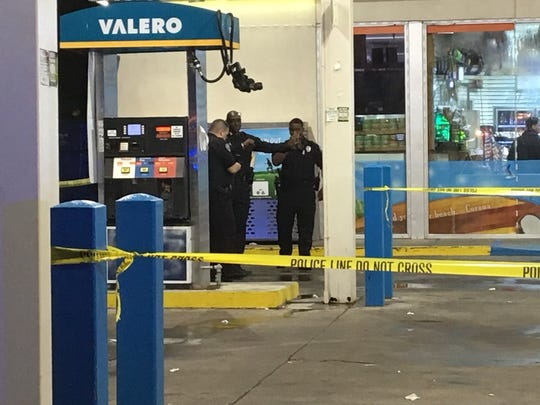 Police on the scene of a fatal shooting at Valero gas station on Cooper Road.
