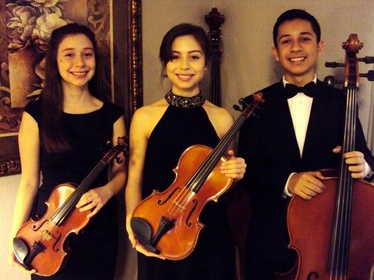 The three Guzman children — Sarai, Alexia and Elijah — were determined to take music lessons.