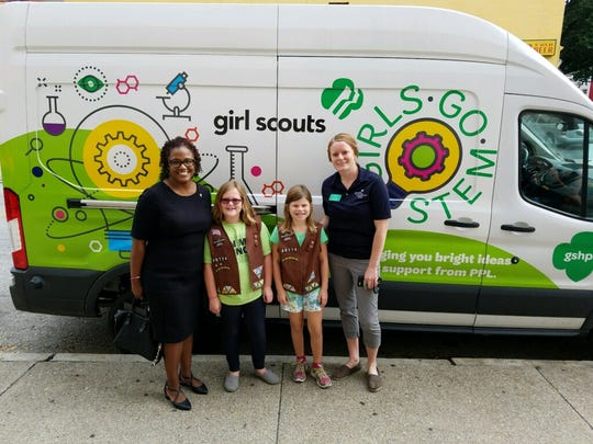 Mayor Kim Bracey poses with Charlotte Evans and Carley Carrozza, both 9, and Julie Queen, Girl Scouts program manager in front of the Girl Scout STEM mobile. Evans and Carrozza are a part of Brownie Troop 20774, made up of 2nd and 3rd graders, that meets by the West Manchester Mall.
