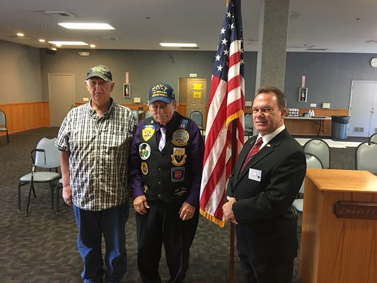 Military veterans Doug Bamforth (left) and Nick Nickson (middle) pose at Simi Valley Elks Lodge 2492 with the lodge's exalted ruler, Keith Scott (right). All three are critical of NFL players who take a knee during the playing of the national anthem before games.