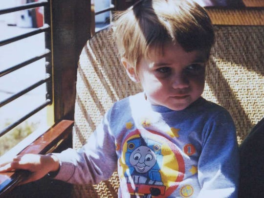 Harry Fairbanks is pictured here at age 3 wearing a Thomas the Tank Engine shirt. Harry was 3 when he was diagnosed with autism.