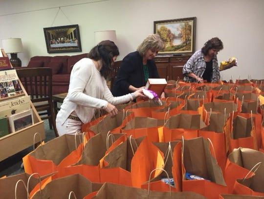 Volunteers from First Presbyterian Church fill bright