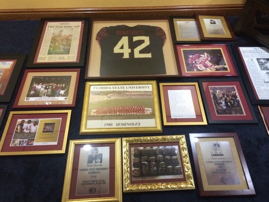 Photos and news clippings that will adorn the basement
