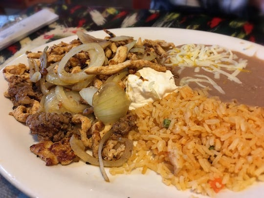 El Gallo Giro serves a grilled mix of chicken, chorizo and onions for less than $7 at lunch.