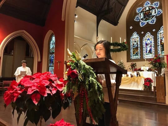 Roxanne Hermann-McNamara reads for the congregation on Monday morning. She and her father, Matthew McNamara, a City of Poughkeepsie Common Council member, sat in a pew together.
