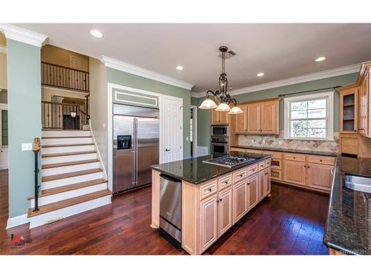 This two-story home features a spacious kitchen with a center island.