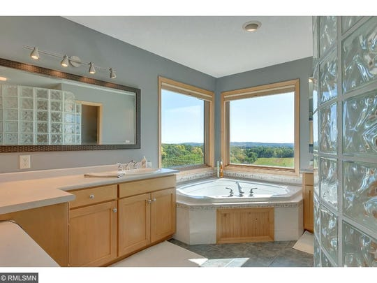 The en suite master bathroom offers a particularly satisfying vantage point; you can recline at ease in a private whirl pool, facing the open corner windows, without a care in the world