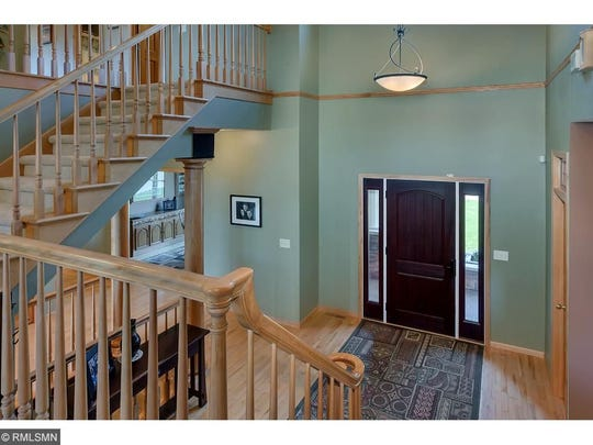 The main floor is the active hub of the house. This is evident from your first step into the welcoming entry area – with its soaring ceiling and wide staircase to the upper floor.