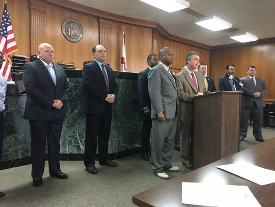 Officials announce indictments and arrests of 11 for