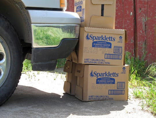 In this April 10, 2017 file photo, boxes of bottled