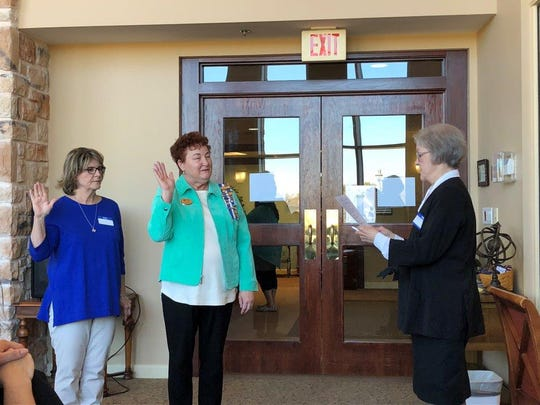 Kathy Turner and Cody Allen are welcomed into the John Davis Chapter of the Daughters of the American Revolution by chapter chaplain Sharron McClellan.