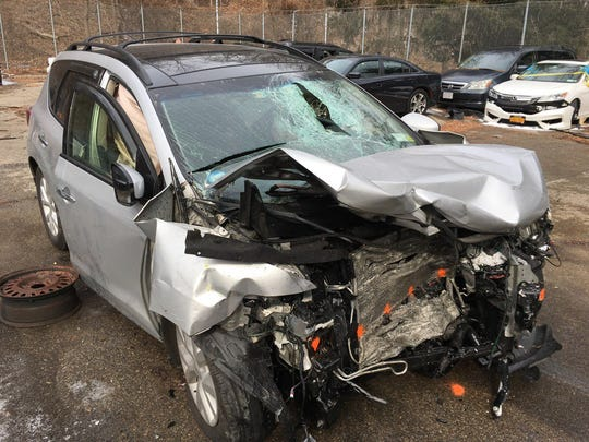 Nissan Murano that was headed the wrong way on the Bronx River Parkway and slammed into a rented Dodge Journey carrying six relatives who had just arrived from Florida, Feb. 9, 2018. The Murano's driver, Diego Caceres of New York City, was charged with drunken driving and other charges.
