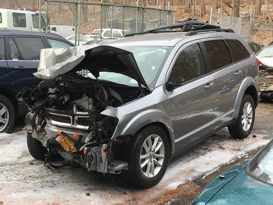 Dodge Journey that was slammed head-on by a wrong-way