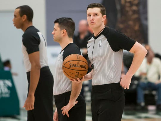 NBA G League referees officiate Saturday's game between the Wisconsin Herd and the Long Island Nets at Menominee Nation Arena February 10, 2018.