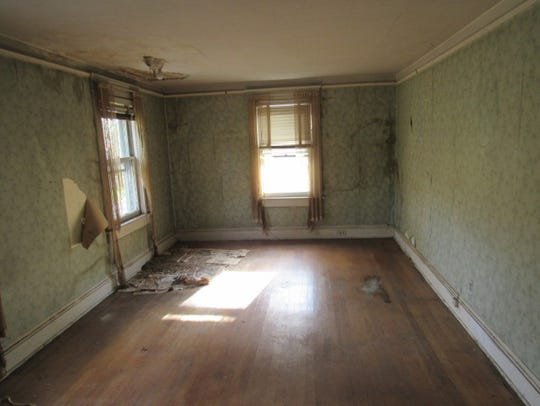 Although it needs work, a 1900 Garrison home has  large