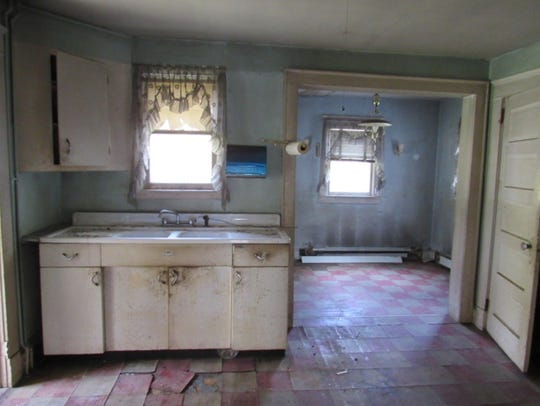 The kitchen in a 1900 Garrison fixer upper features