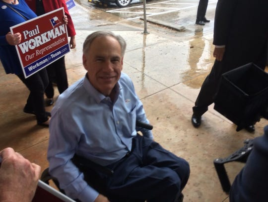 Gov. Greg Abbott votes early in Austin on Feb. 20,
