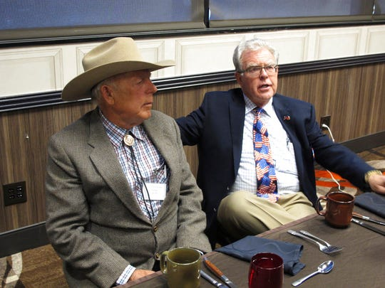 Southern Nevada rancher Cliven Bundy, left, listens to Independent American Party of Nevada Chairman Joel Hansen before Bundy was scheduled to give the keynote address to the third-party's state convention at the Nugget hotel-casino, Friday, Feb. 23, 2018, in Sparks,.