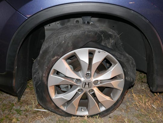 Police said a woman driving on four flat tires was