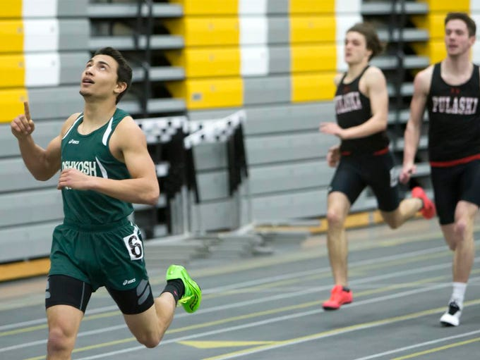 Oshkosh North's Ray Brewer crosses the finish line