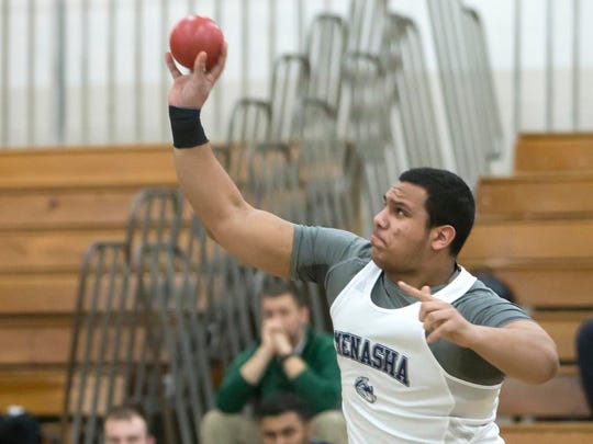 Menasha's Abe Elzazy throws a shot put March 13 during the Oshkosh High School Invitational at Kolf Sports Center in Oshkosh.