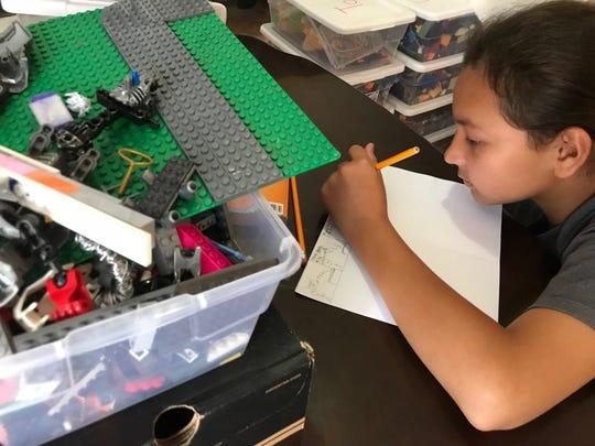 "Sage Dela Cruz works on the stop motion film ""Brain Child."""