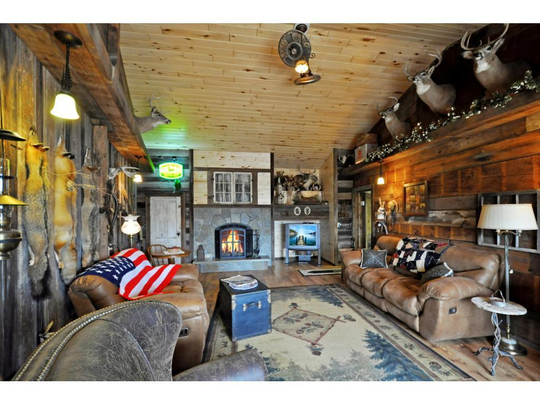 A true highlight of the home is the rustic living room