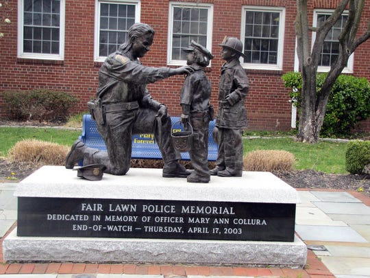 The statue to honor fallen Police Officer Mary Ann Collura in front of town hall in Fair Lawn. Collura died on duty in 2003.