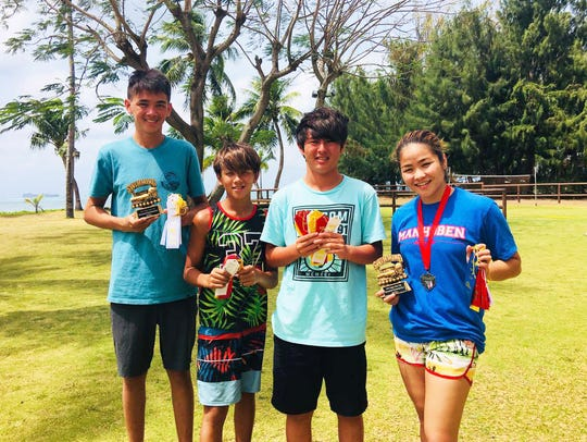 Members of the Manhoben Swim Club also returned from the Saipan International Swim Meet with some hardware. Pictured, from left: Santiago Poppe, Israel Poppe, Taiga Sato and Mineri Gomez.