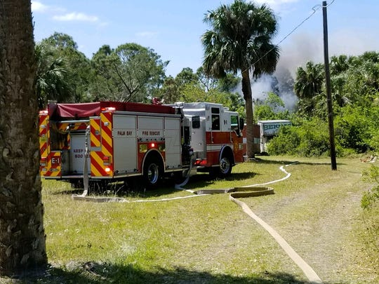 Firefighters contained a brush fire to an acre Thursday