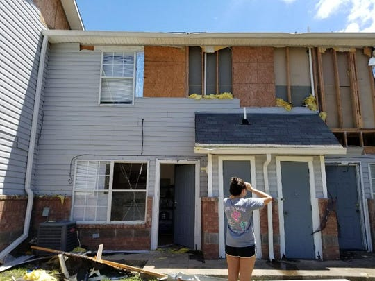 Jessica Hernandez surveys the damage to her apartment after returning to Rockport following Hurricane Harvey. The apartment complex was a total loss and she was unable to retrieve many items from her home.